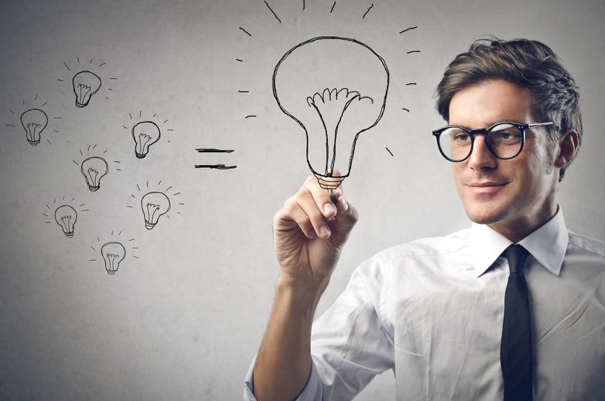young businessman drawing a lightbulb