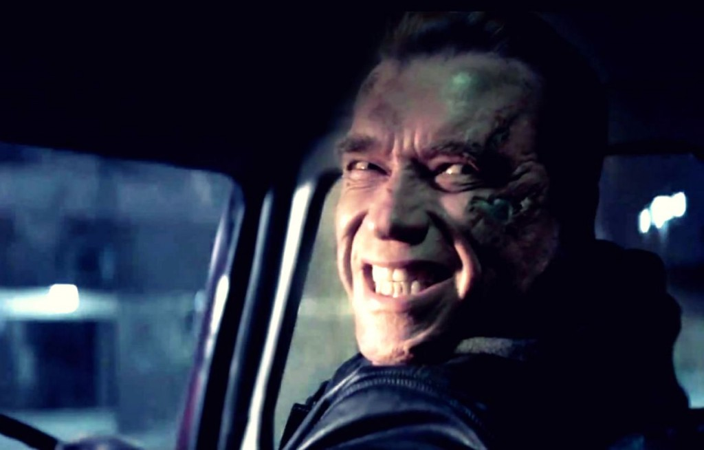 Arnold Schwarzenegger smiling while driving car