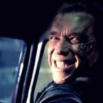 Arnold Schwarzenegger smiling while driving car