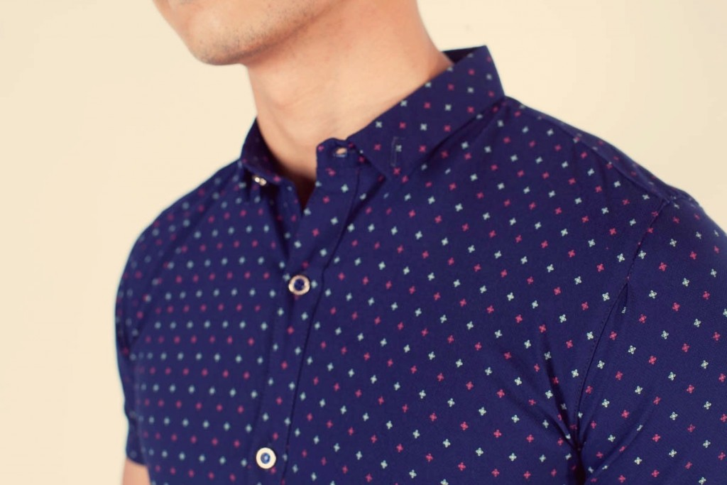 man wearing short sleeve button down - three quarters view