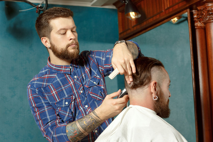 barber giving man haircut