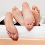 a couple feet in bed love, sex and partners
