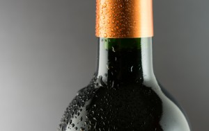 close up of wine bottle neck covered in condensation