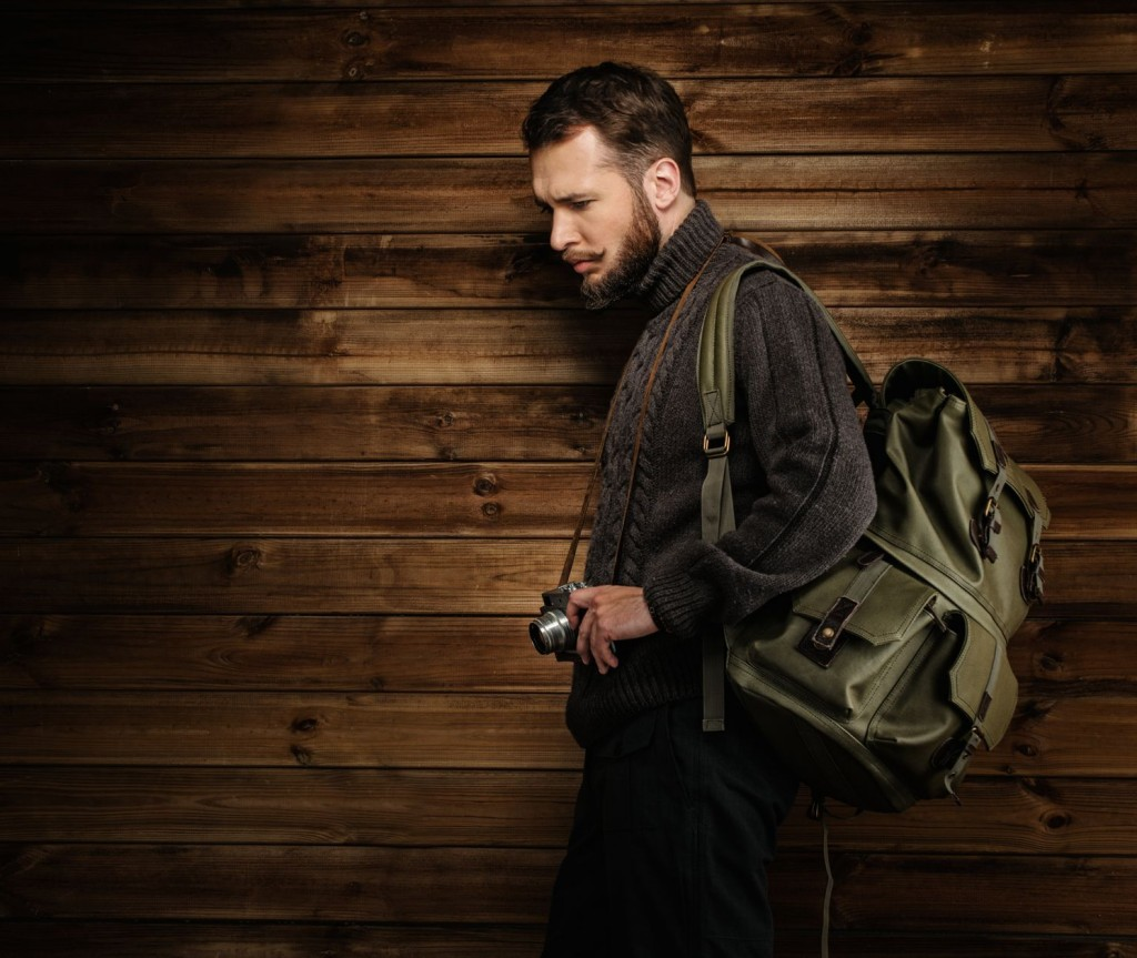 man showcasing travel backpacks for men
