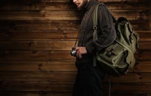 man showcasing travel backpacks for men