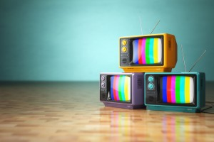 three televisions with colored stripes on screens
